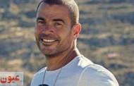 عمرو دياب يرتدي حلق في إعلان عطره الجديد
